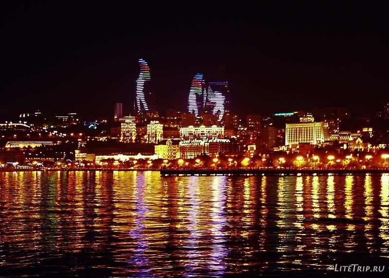 Азербайджан. Пламенные башни Баку - человек с флагом.