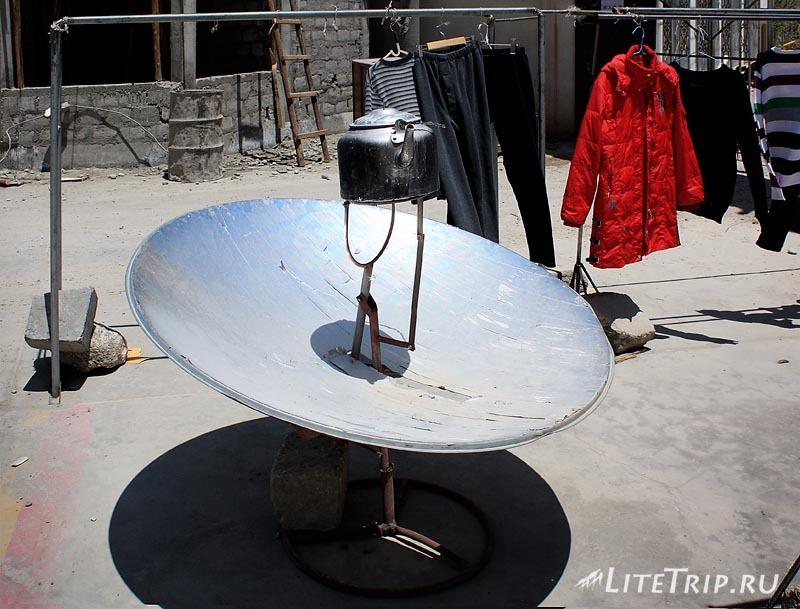 Тибет. Кипячение чайника на солнце.
